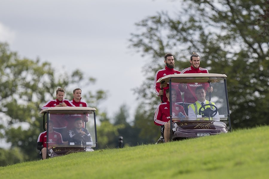 Footballer Gareth Bale and his Wales team-mates arrive for national team training in golf buggies at Hensol Castle, Vale of Glamorgan, Wales, August 2015.