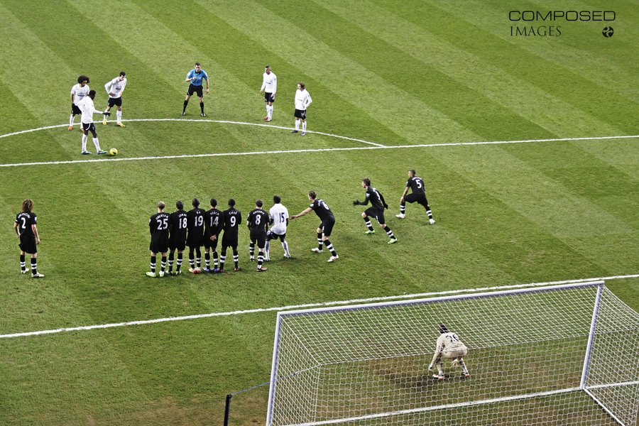 Emmanuel Adebayor inexplicably tees up Benoit Assou-Ekottu to shoot over the goal, while Bale, Kyle Walker, and Modric look on. Taken from the stands as a fan in February 2012 during the 5-0 win over Newcastle United.