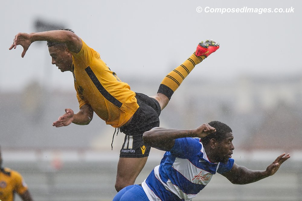 Nathan Ralph of Newport County (left) and Jay Emmanuel-Thomas of QPR in an aerial challenge during the pre-season friendly between Newport County and Queens Park Rangers at Rodney Parade, Newport, July 26th 2015.