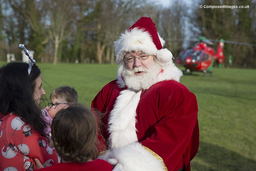 Father Christmas, flown in by Wales Air Ambulance, visits children's hospice Ty Hafan in Sully, South Wales.