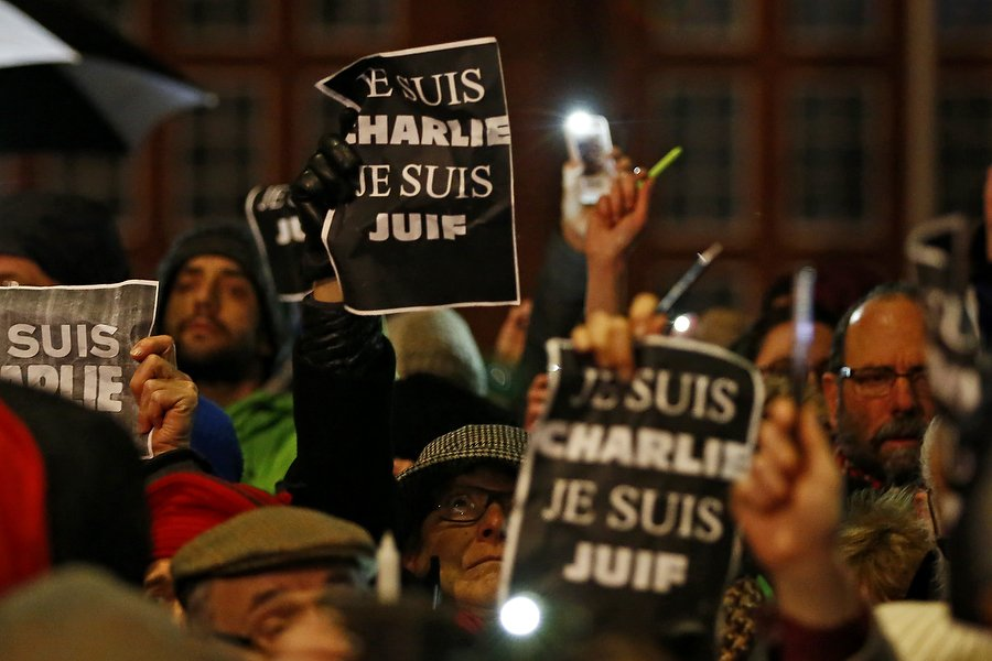 Victims of Charlie Hebdo massacre honoured with silent rally in Cardiff Bay